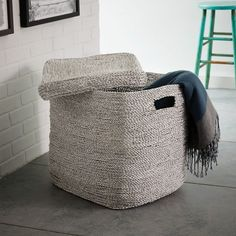 Crafted from recycled materials such as candy wrappers, this metallic basket can act as a hamper that you'll actually want to show off or a stylish setting to stow extra linens; $129. westelm.com