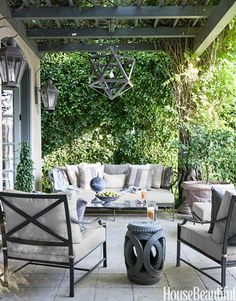 Outdoor seating under pergola. Plant climbing up pergola. Side, arm chairs, drum end chair. Outdoor Decor, Outdoor Patio Furniture, House Beautiful Magazine Living Room, Outdoor Space, Grey Patio, House Beautiful Living Rooms, Gray Patio Furniture, Outdoor Rooms, Beautiful Homes