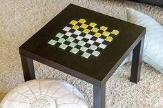 Family game night is a tradition that people of all ages can enjoy. All you need to transform an everyday side table into a game table fit for checkers (or chess) is simply paint, masking tape and wooden discs to make your own game pieces.