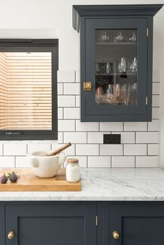 Carrara marble worktops and a lovely Shaker wall cupboard painted in Pantry Blue Може и с subway плочки за backsplash вместо пак мрамор Treatment Projects Care Design home decor Shaker Style Kitchen Cabinets, Dark Grey Kitchen Cabinets, Wooden Kitchen Cabinets, Shaker Style Kitchens, Kitchen Cabinet Styles, Painting Kitchen Cabinets, Kitchen Tiles, Home Kitchens, White Cabinets