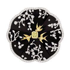 broche Camélia Coromandel de Chanel Joaillerie en or blanc et jaune 18 carats, diamants blancs, jaunes et laque noire.