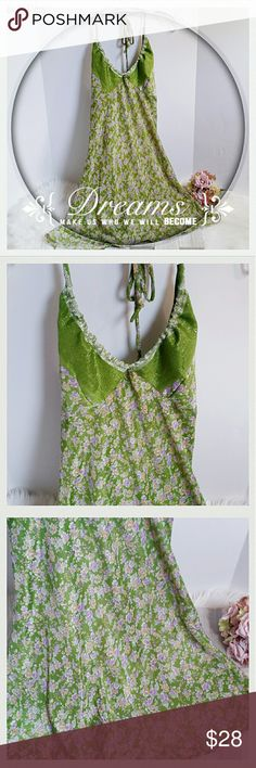 "Dharma Silk Sundress Dharma Silk Sundress size small/medium. 100% silk and halter tie top. Beautiful silver detailing around halter. Embroidery on solid green halter area. Length: 35"".  Chest (underarm to underarm front:) 16"". (#E97) Dharma  Dresses Midi"