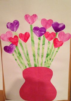 Valentine's Day Flower Craft - child paints a piece of paper then helps cut out the hearts and flower stems - Preschool Craft - Heart Craft