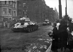 German people watch helplessly as Soviet tanks trundle on the streets of Berlin. Battle of Berlin. Berlin 1945, Soviet Army, Red Army, American Soldiers, Panzer, War Machine, Pictures Images, Military History, World War Two