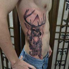 man belly deer tattoo