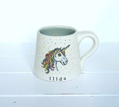 Personalised Ceramic Unicorn Mug Created with earthenware clay handthrown on a traditional potters wheel. The unicorn is then handpainted creating a completely unique keepsake and functional anti-spill mug. A gorgeous unicorn themed gift idea Unicorn Gifts, Cute Unicorn, Personalised Mugs, Earthenware Clay, Hand Painted, Ceramics, Traditional, Create, Lady