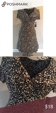 👠 CHAPS Dress New With Tags. Black and cream with flower print.  Large. Gorgeous CHAPS dress.                               ✨Top Rated Seller✨ 💨 Fast Shipping 💨 💕 Quick Responses 💕  ✅ Great Items ✅ 🛍Awesome Bundle Deals 🛍 😁 Thanks for looking! 😁 Chaps Dresses