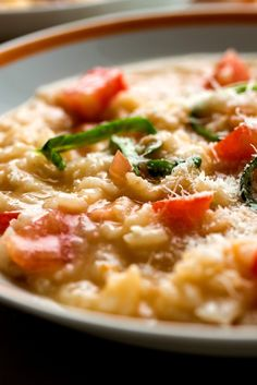 NYT Cooking: This is a luxurious summer risotto, with tomatoes both cooked along with the rice and added uncooked to the finished risotto.