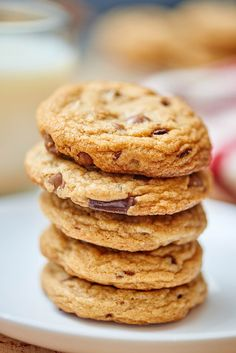 These chewy chocolate chip cookies are my version of the best chocolate chip cookies! They're soft, and chewy, with a slight crunch on the outside. It's the perfect textured cookie! I use not one, but TWO kinds of chocolate and the flavors of the butter and vanilla really come through! With a 1/2 teaspoon of salt, it contrasts the sweetness wonderfully! showmetheyummy.com #chocolate #chocolatechips #cookies #chocolatechipcookies #dessert