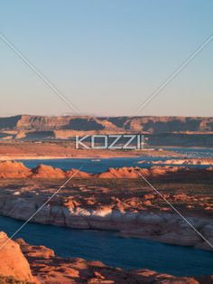 high angle shot of river and mountain range. - High angle shot of river and mountain range with clear sky in background.