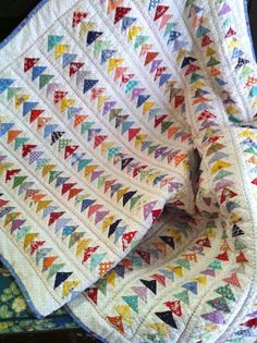 Clutterbliss: Oscar's Quilt, 30's reproduction fabrics and hand quilted with different color threads-love!