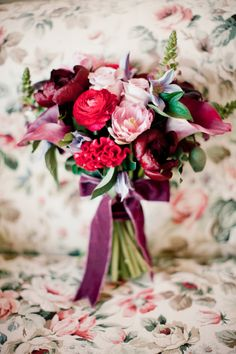 Berry colored bridal bouquet with ribbons | Anastasiya Belik Photography | http://burnettsboards.com/2013/12/mixed-berry-wedding-color-palette/