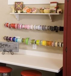 Hang a ribbon collection on rods over a table. This allows you to pull off the lengths of ribbon you need and cut them to size. A small shelf above is the perfect display for your pincushions. Sewing Room Storage, My Sewing Room, Sewing Rooms, Sewing Spaces, Creative Storage, Storage Ideas, Organize Fabric, Quilting Room, Sewing Table