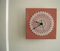 crochet clock. I wonder what it's placed on... would love to DIY this
