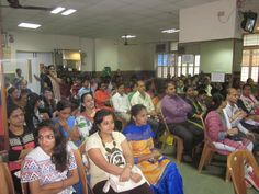 Parents sitting in hall and listening to the tips at workshop at school.