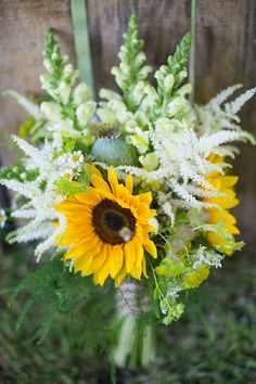 Sunflowers and poppy head rustic wedding bouquet!