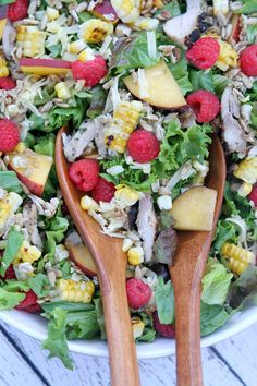 Grilled Chicken Summer Salad Recipe: fresh greens with grilled pesto chicken, raspberries, peaches, grilled corn and candied sunflowers seeds... tossed with a balsamic vinaigrette!