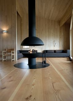 A large wood living room for a focal point fire place.