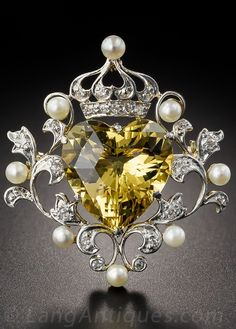A late Victorian platinum topped yellow gold, beryl, diamond and seed pearl brooch, circa 1900. #Victorian #brooch
