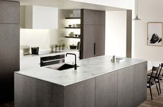 Adding an island is the most common way to achieve multiple work centres in a kitchen An island suits many modern house ...