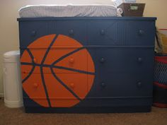 painted basketball dresser that my little sister, @Emily Bass, made for her son! So cute I might have to copy it!!!