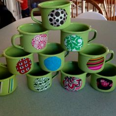 Used some homemade mod-podge to personalize each of the kiddos cups. They each have their own pattern on their mug, their drawer, their hook and, COMING SOON - their napkins & plates. :)