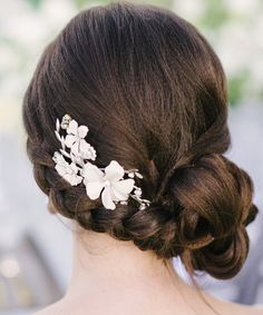 Romantic Low Bun #Wedding #Hairstyles We Heart. To see more: www.modwedding.com