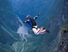 Karina Hollekim is a former BASE jumper sponsored by Red Bull.  Drink the bull and you can fly just like her.