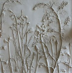 This is really a plaster casting of plants. You might be able to get a similar look by painting over plants. http://www.tactilestudio.co.uk/about/