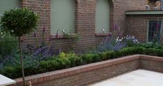 stylish victorian brick garden wall | popular searches garden design wirral garden design chester garden ...
