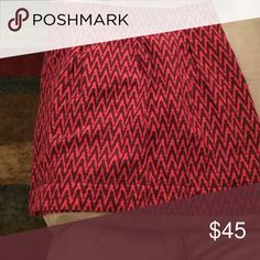 Pink and maroon patterned skirt Barely worn. Loft skirt, zipper in the back. Work appropriate. LOFT Skirts Midi
