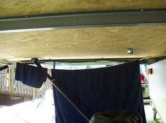 hanging clothes in tent trailer