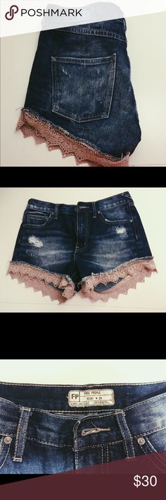 High-waisted shorts from Free People High-waisted, dark-wash jean shorts from Free People with lace detailing at bottom Free People Shorts Jean Shorts