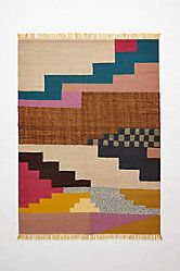 This colorful patterned rug can beautifully connect the various hued items that you have in a room. Fringed Cusco Rug via #anthropologie