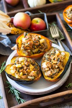 An incredible mix of sweet and savory flavors are packed into this caramelized onion apple and sausage stuffed acorn squash! Paleo