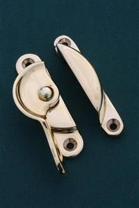 Sash window hardware in period designs in unlacquered brass, the way it used to be. Sash locks, sash lifts, sash fasteners and sash window handles   www.priorsrec.co.uk