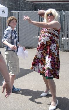 Harbor Ridge Middle School Vice Principal Brian Wickens is a man of his word — or in this case, a woman. Each year Wickens makes a promise to the class that raises the most during the annual school fundraiser. In past years he has shaved his legs and spent a day on the roof. This year he promised don a wig and dress — complete with a special-ordered set of pumps to match. He's seen here throwing a football to some students.