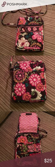 NWOT Vera Bradley cross body purse Never used. Vera Bradley cross bod purse, inside has id holder in front, &a zip closure with flap that goes over and Velcros, the outside of flap has zip compartment, the back also has a large compartment Vera Bradley Bags Crossbody Bags