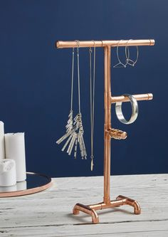 Add some industrial charm to your dressing table with our funky Copper pipe jewellery stand. This handmade bracelet and necklace holder is on trend and stylish whilst being practical. - July 21 2019 at Jewellery Storage, Jewelry Organization, Jewellery Display, Jewellery Box, Jewellery Shops, Earring Storage, Bracelet Display, Beaded Jewellery, Jewellery Earrings