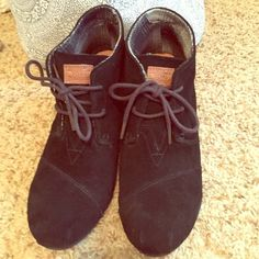 Black Suede TOMS Lace-up Wedges I have worn these one time. Very comfy and cute, but I have the same pair in tan that I wear a lot more because I don't usually wear a lot of black. In great condition! Bought for around $100 new. No trades, please. They are a women's sz. 10, but I am a true 9.5 and they fit me. TOMS Shoes Lace Up Boots