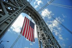 The world's largest free-flying American flag unfurls on the George Washington Bridge in Fort Lee for Flag Day.