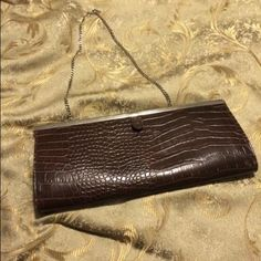 Aldo clutch Brown clutch with silver hardware - good condition- some stains inside ( pictured above ) no scratches on the outside ALDO Bags Clutches & Wristlets