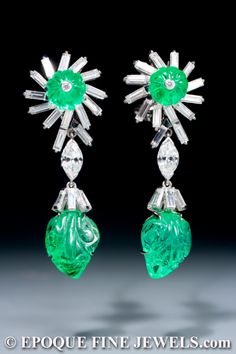 DAVID WEBB An unusual pair of carved emerald and diamond earrings,each set with baguette cut, marquize shaped and round cut diamonds and two carved emeralds. Emerald Earrings, Emerald Jewelry, Enamel Jewelry, Antique Jewelry, Vintage Jewelry, Antique Earrings, David Webb, Jacqueline Kennedy Onassis, Helen Mirren