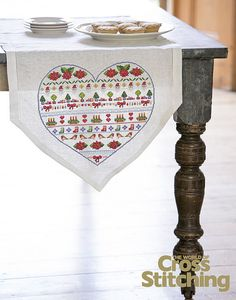 Dress up your Christmas dinner with a festive table runner idea - find the cross stitch chart in the new issue of The World of Cross Stitching mag, 210