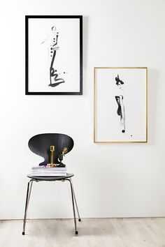 Illustrations with bold but elegant lines, such as these by Lovisa Burfitt, match well with a simple black frame or a delicate golden one. For extra glamour, put another touch of gold nearby, like this candle stick.