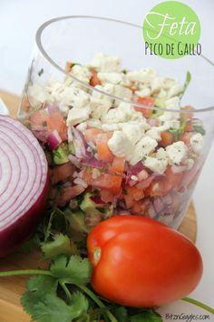Feta Pico de Gallo - a beautiful twist on the traditional Pico de Gallo recipe, replacing some of the original ingredients like jalapeño and lime with feta cheese, red wine vinegar and olive oil. Addicting but so good for you! {BitznGiggles.com}