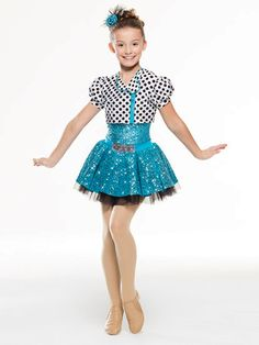 NEW! 2017 Collection Jazz & Tap Costumes: Spandex leotard with sequin spandex overlay has a spandex waistband with faux rhinestone buckle and extended bike-shorts leg line. Attached skirt is layers of organdy under sequin lycra. Separate spandex jacket features a fully functioning zipper.  Includes headpiece, bobby pins, hanger and garment bag.
