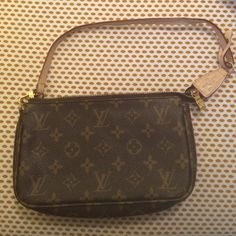 Louis Vuitton clutch wristlet bag Small handbag can be used as a wristlet, clutch or shoulder bag. Great for going out. Louis Vuitton detail is great down to the zippers. Cleaning lining, maybe used once. Bags Clutches & Wristlets