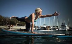 Paddleboard yoga ...This will be me! ~G