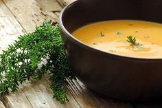 A Veritable Fall Cornacupia, Cream Soup of Apple, Carrot and Pumpkin Decorated With Thyme.